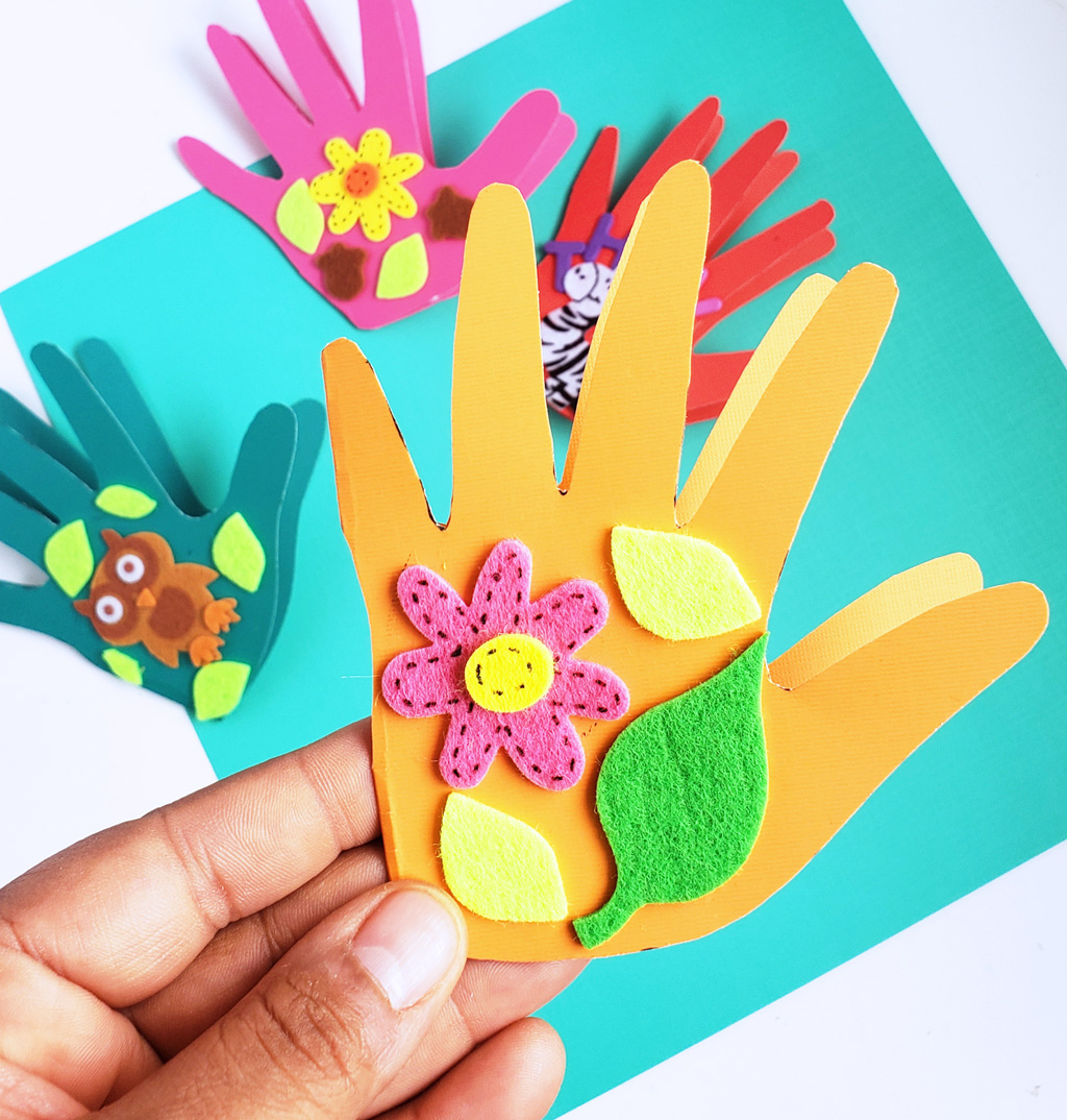 Easy DIY Thanksgiving Cards made with hand prints and stickers on colored craft paper. Perfect for teachers and parents. #thanksgivingcrafts #diythanksgiving