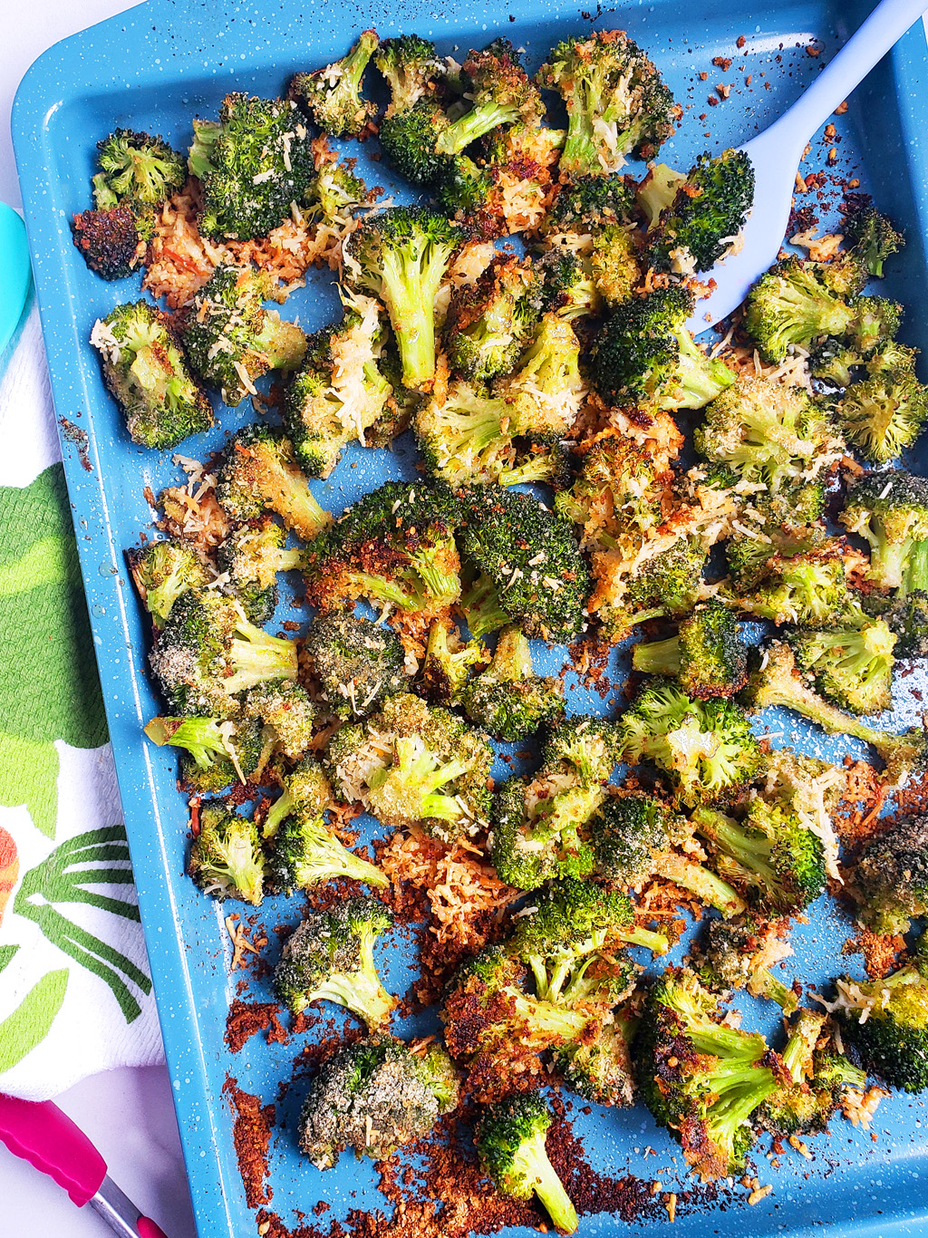 Quick & Easy Parmesan Roasted Broccoli on a blue sheet pan