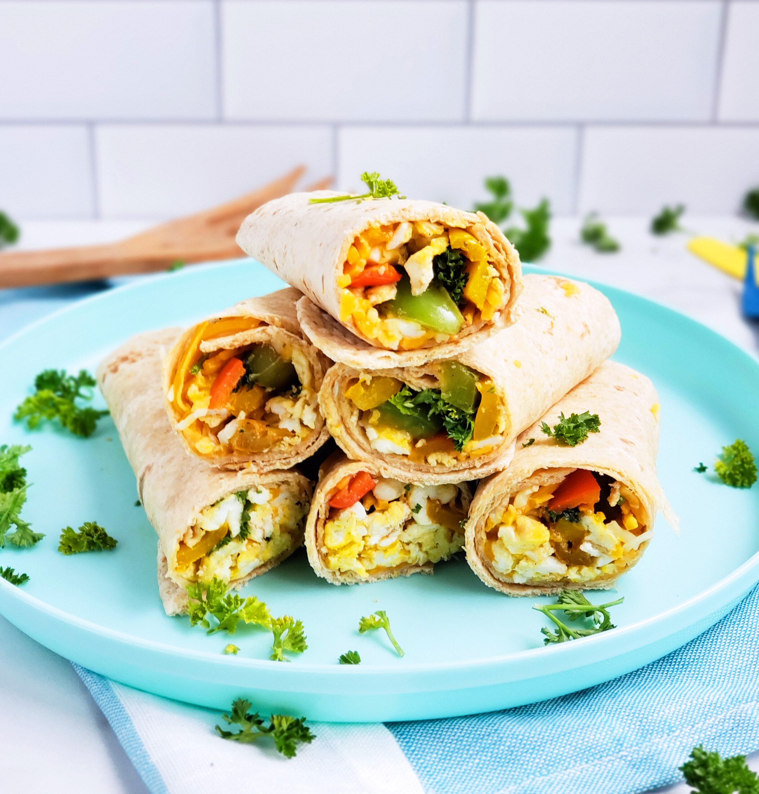 Cheesy Veggie & Egg Breakfast Roll-Ups, the perfect kid-approved, toddler-approved meal. #healthykids #kidsinthekitchen #breakfastwraps