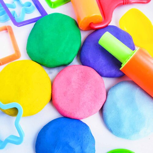 Easy No-Cook DIY Playdough, made with no cream of tartar, and no cooking required. The easiest playdough recipe ever. Different color playdough and utensils. #sensoryactivities #indooractivitiesforkids #indooractivities #homemadeplaydough #playdoh