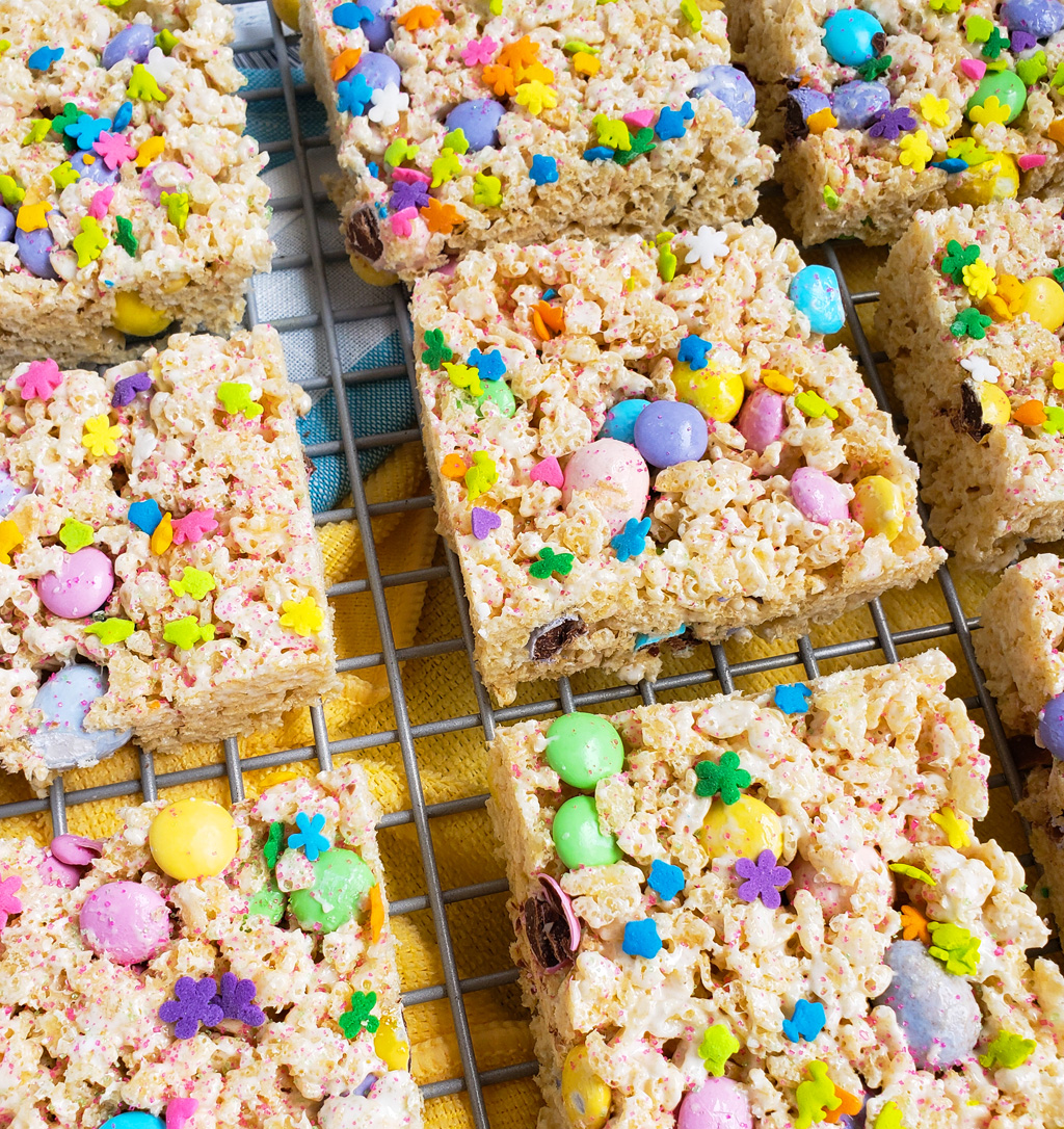 The Best Easter Rice Krispies Treats made with M&Ms, Cadbury eggs, and sprinkles. Cut into squares on a wire rack. The perfect Spring treats