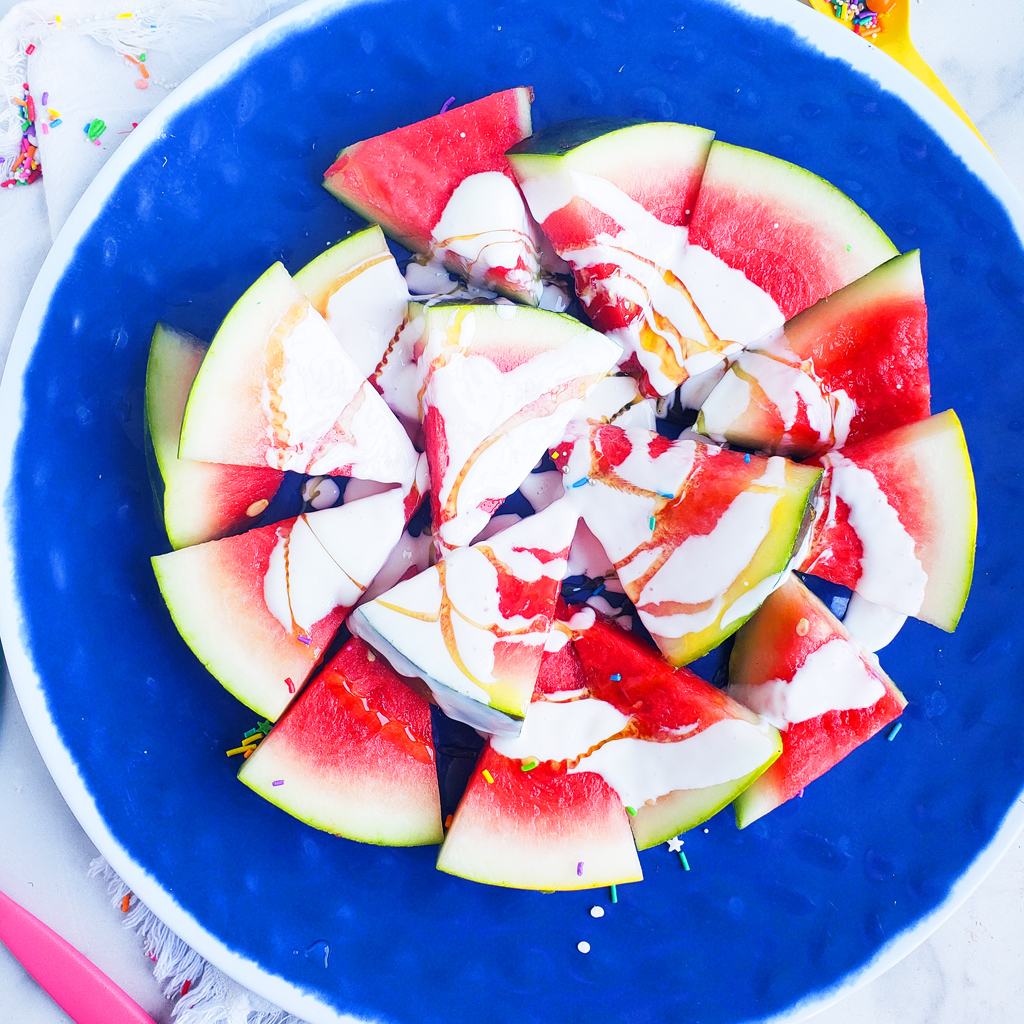 Fun & Easy Sweet Watermelon Nachos made with vanilla Greek yogurt, honey, and sprinkles. The perfect summer treat, also great for the 4th of July. Littleeatsandthings.com