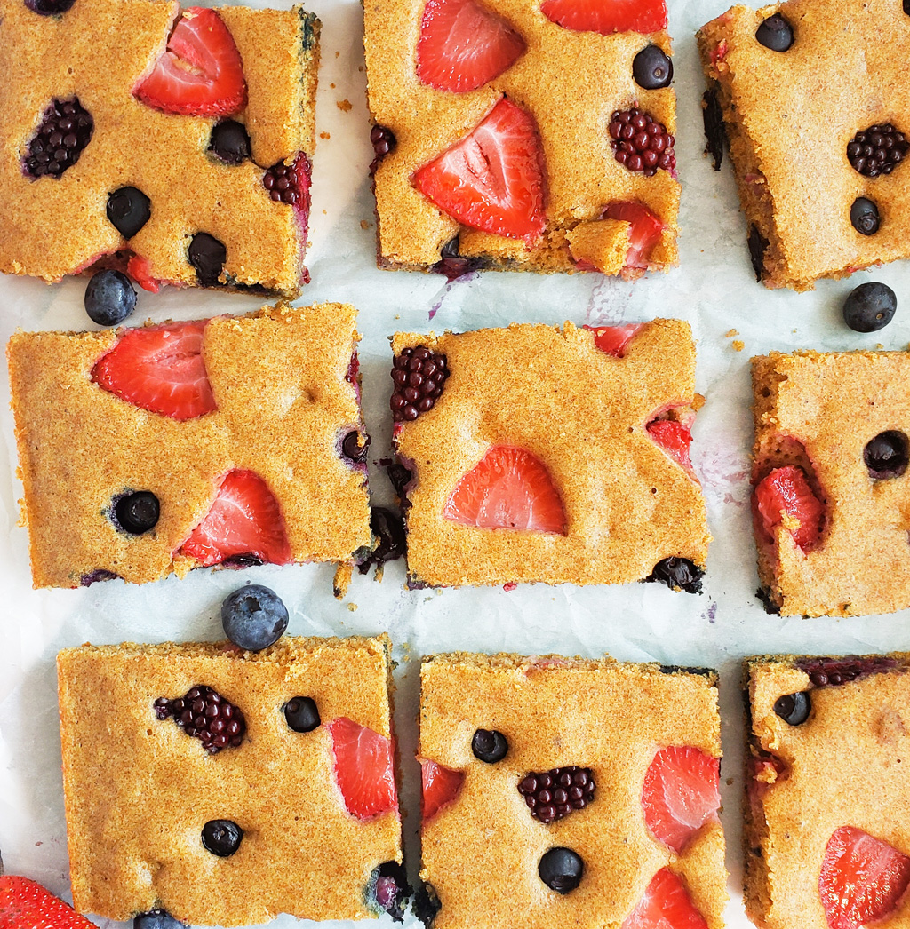 These Very Berry Sheet-Pan Pancakes are an easy, wholesome breakfast that the whole family will enjoy! Made with whole wheat flour, strawberries, blueberries, and raspberries. Littleeatsandthings.com