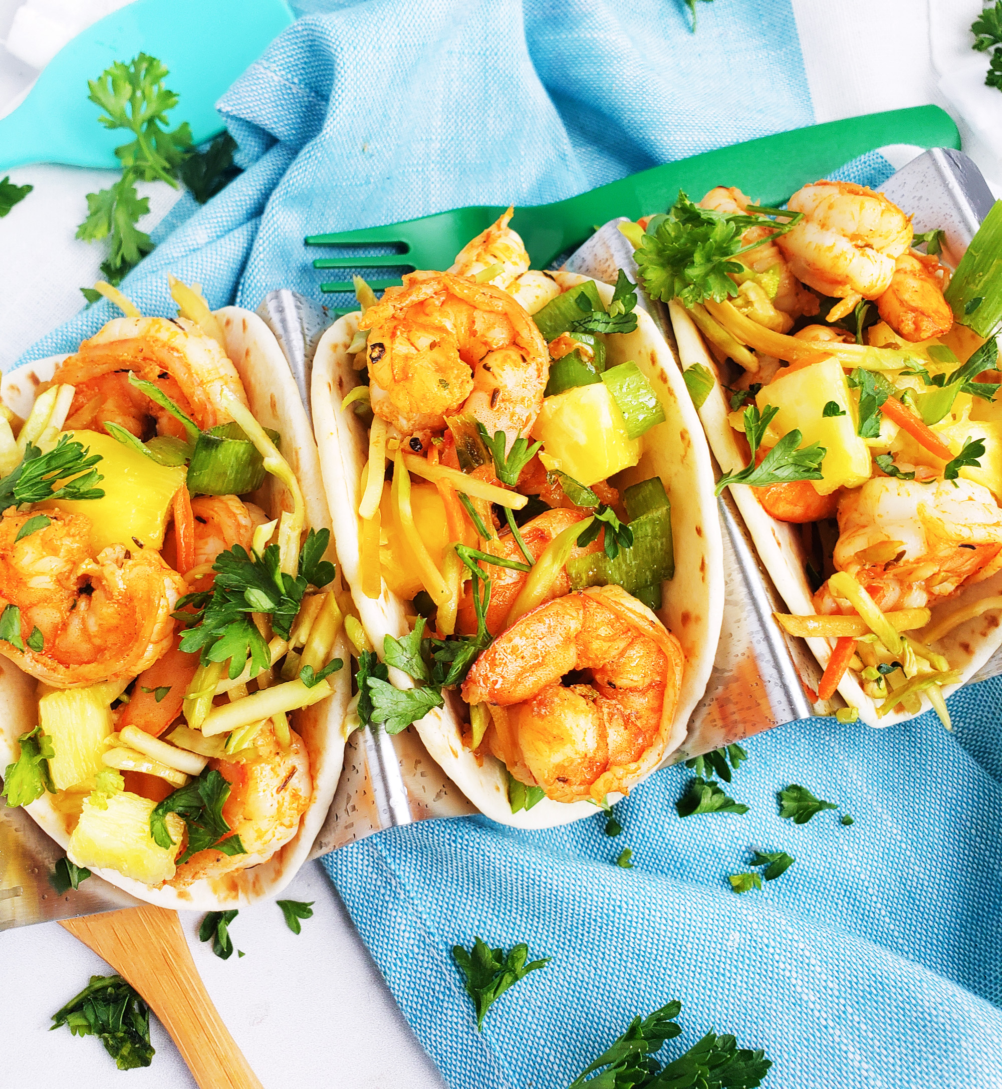 These Spicy Jerk Shrimp Mini Tacos are loaded with so much flavor and super easy to make! These street tacos are piled high with marinated slaw, jerk shrimp, pineapple, and green onions. Littleeatsandthings.com