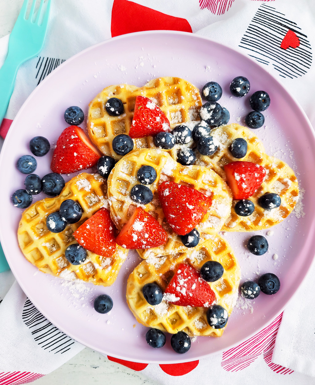 These Berry Yummy Mini Heart Waffles make the perfect Valentine's Day breakfast! So light and airy… and topped with delicious blueberries and strawberries.