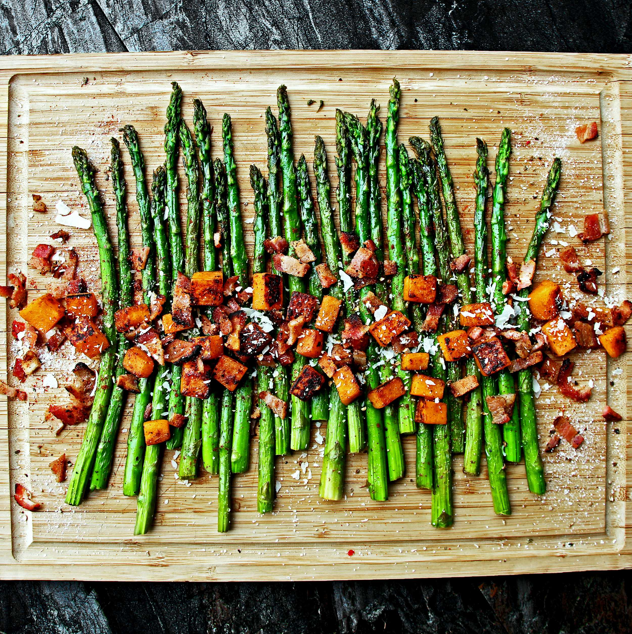 Roasted Asparagus & Sweet Potatoes with Homemade Bacon Bits, Shaved Parmesan & Coarse Seasonings.