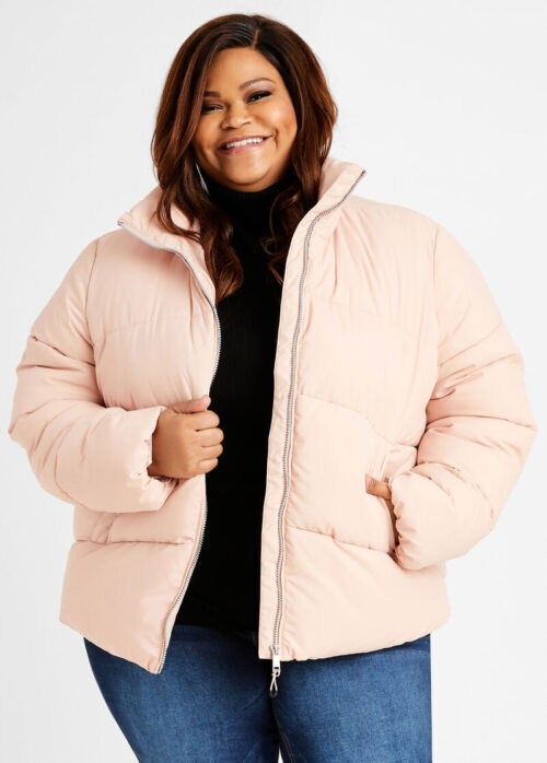Plus-sized Black woman in pink quilted jacket