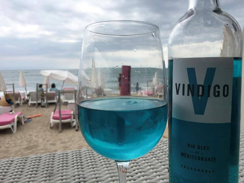 A glass of Vindigo, the blue wine