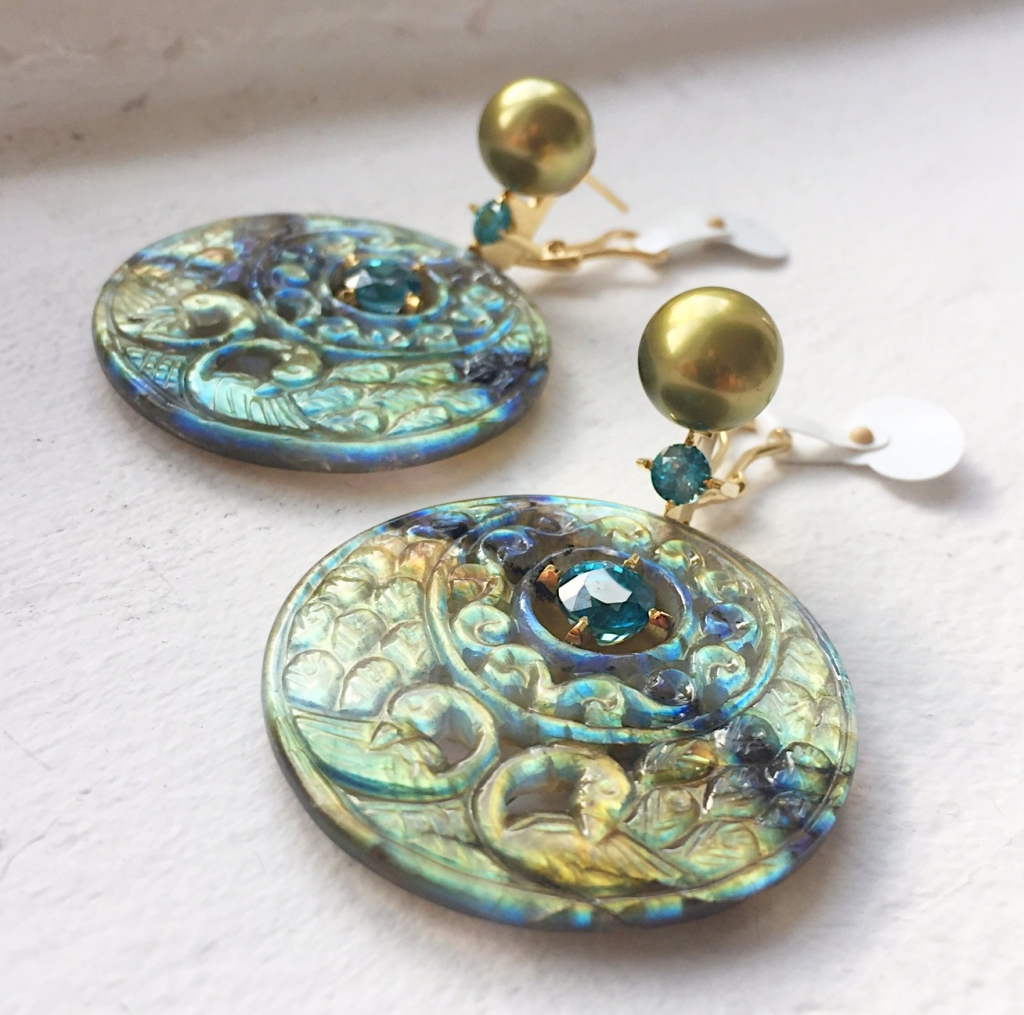 Kunming Remains with Me earrings in 18k yellow gold with carved labradorite, green pearls, and blue zircon by Heath London Jewelry; 805-698-0100; heathlondon@gmail.com