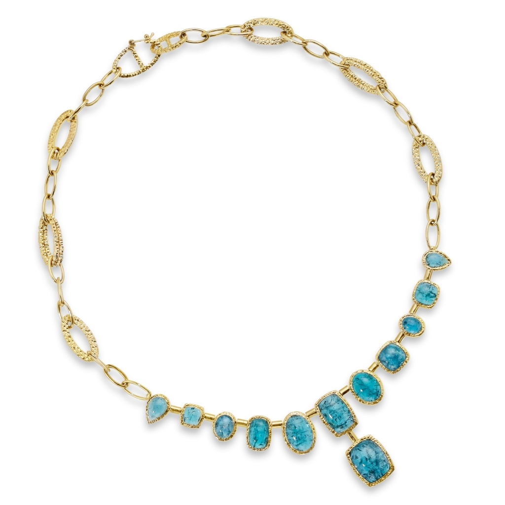 Necklace in 14k yellow gold with cabochon-cut Indicolite tourmaline, $18,600; Contact  jonathanf@parlegems.com for purchase