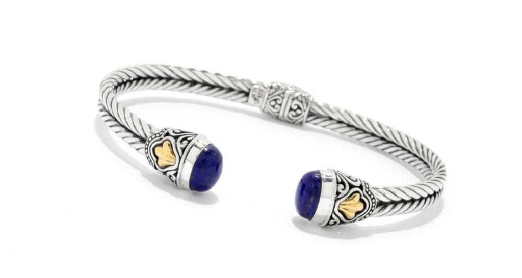 Hinged Open bangle in sterling silver with 18k yellow gold accents and lapis, $282; Samuel B. at Barnes Jewelry