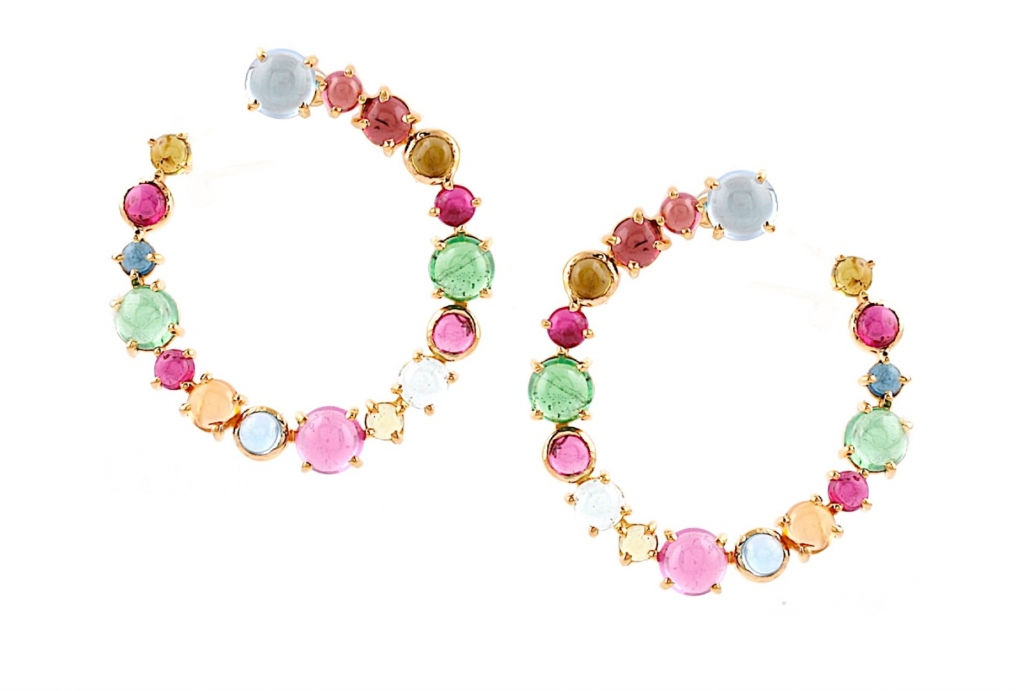 Bypass-style hoops in 18k yellow gold with 8.5 cts. t.w. pink tourmaline, tsavorite garnet, blue topaz, peridot, citrine, and amethyst, $1,800; email klodi@tresorcollection.com at Trésor Collection for purchase