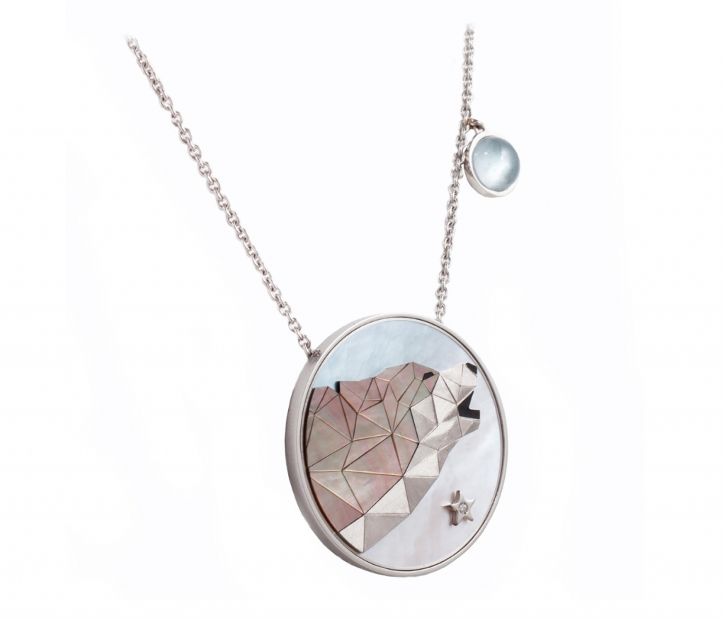 Necklace from Anna Maccieri Rossi depicts a wolf howling at a moonstone moon.