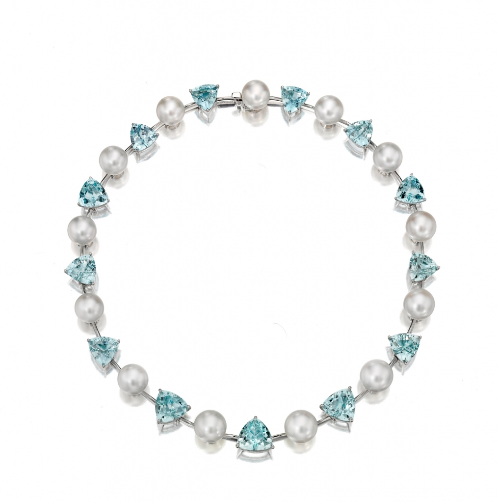 Necklace in 18k white gold with 13 cultured white South Sea pearls ranging in size from 12 to 13mm) with 81 cts. t.w. trillion-cut aquamarines, $76,000; email pgrosz@assael.com at Assael for purchase.