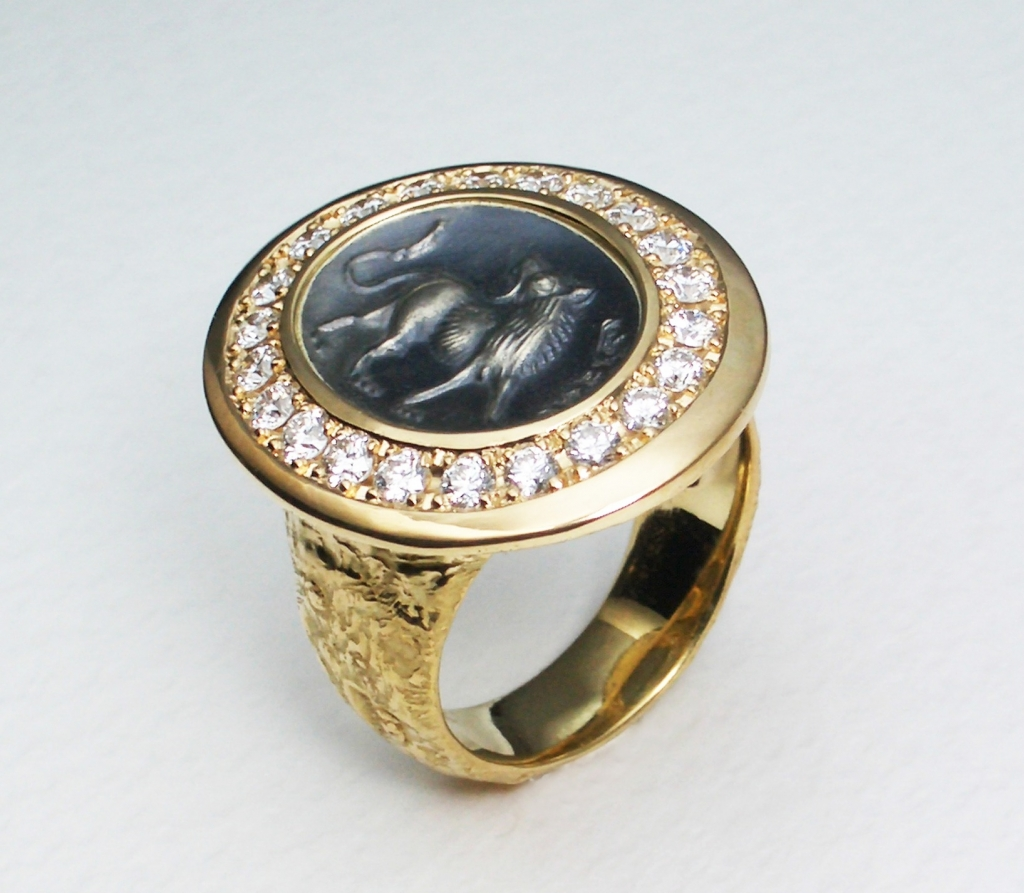 Ring in 18k gold and sterling silver with 0.80 ct. t.w. diamonds and a lion intaglio inspired by an original motif circa 500–800 BC, $9,700; email jurio@kcc.zaq.ne.jp at Jurio Fujita for purchase