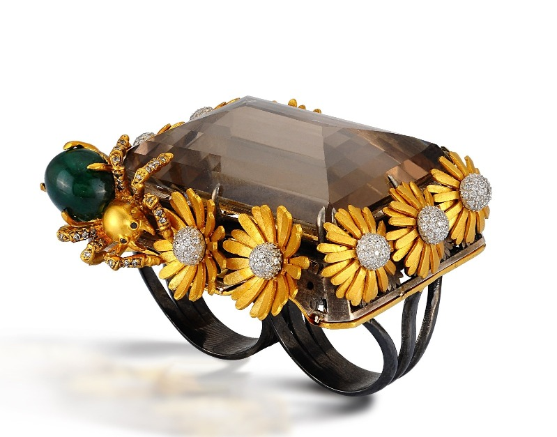 Two-finger Daisy ring in 18k yellow gold and oxidized sterling silver with a massive smoky quartz, a 3.92 ct. cabochon cut emerald, and 1.31 cts. t.w. diamonds, $19,500; email Info@aidabergsen.com at Aida Bergsen for purchase