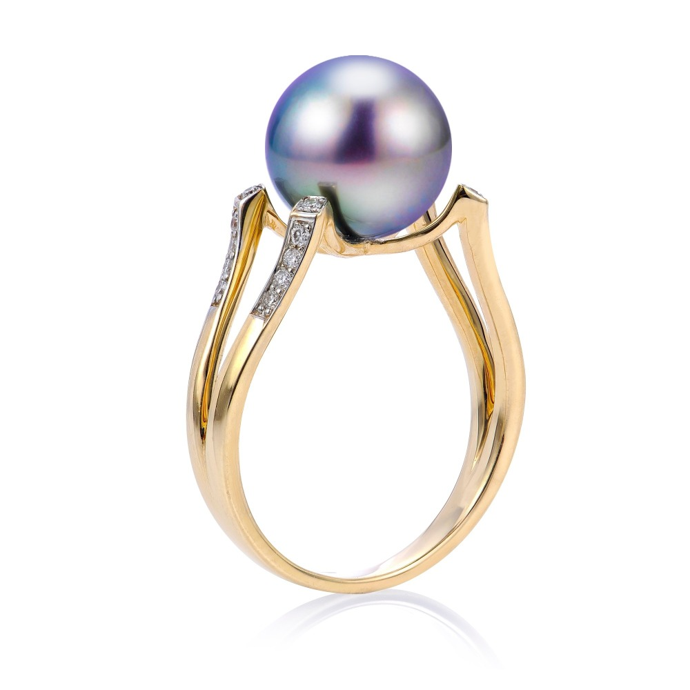 Ring in 14k yellow gold, a peacock-color Tahitian pearl, and diamond accents, $1,875; can be purchased through Montica Jewelry at (305) 446-2957