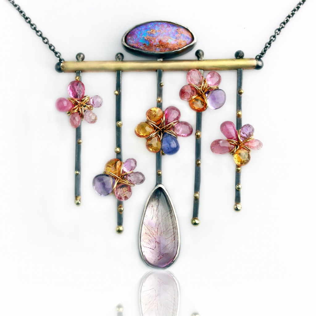 Flowers on a Trellis necklace in oxidized silver with 14k and 18k yellow gold with Boulder opal, pink sapphires and tourmalines, Spessartite garnet, amethyst, and tanzanite, $1,800; available online at Fuss Jewelry