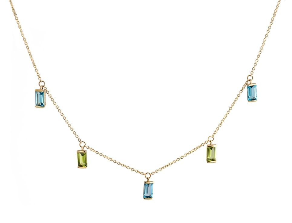 Bon Bon necklace in 14k yellow gold with blue topaz and peridot, $2,050; available online at Emily Kuvin