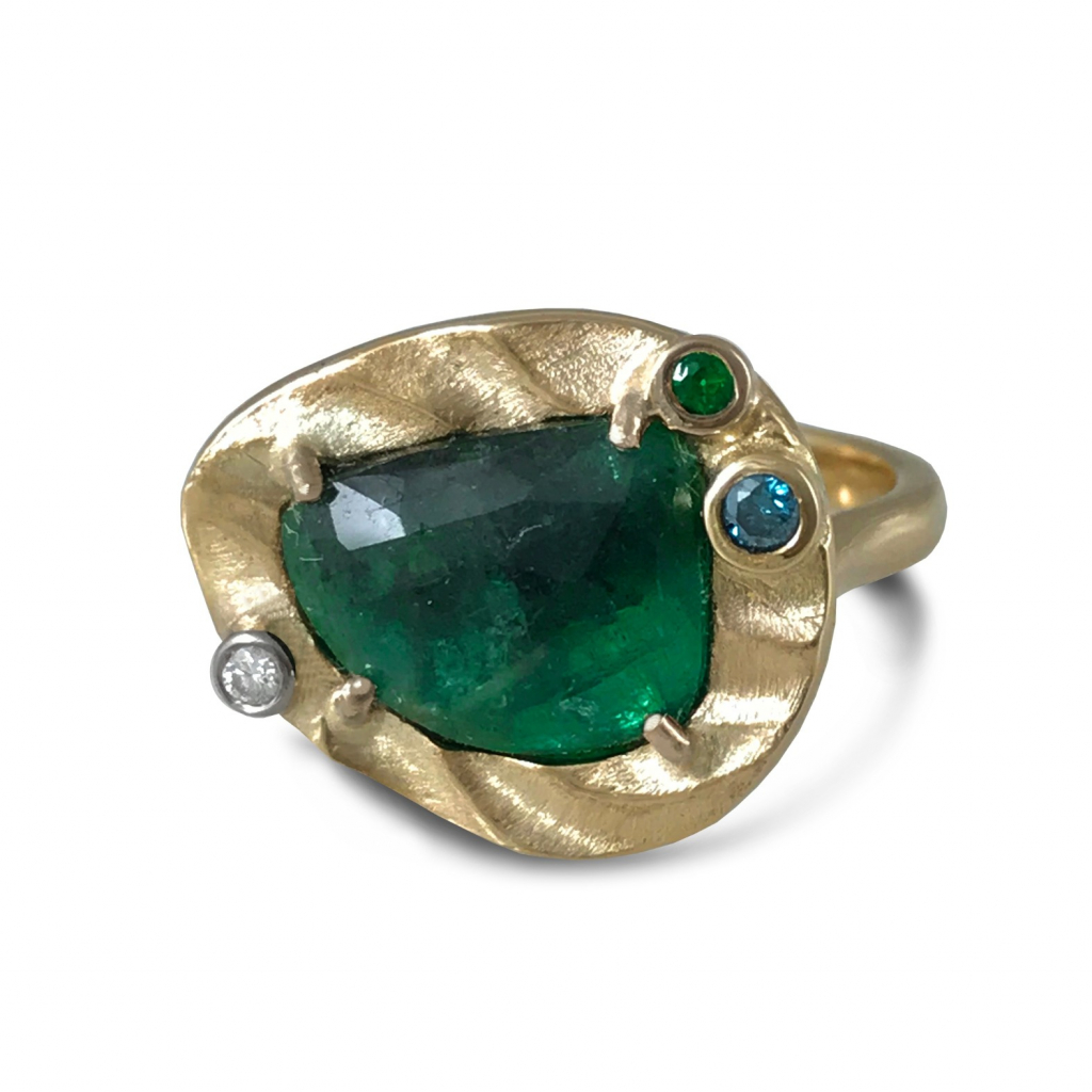 Sea Breeze ring in 14k yellow gold and 14k palladium white gold with a 2.4 ct. emerald, a 0.035 ct. blue diamond, a 0.03 ct. green garnet, and 0.01 ct. diamond, $1,870; email design@k-mita.com at Keiko Mita Jewelry for purchase