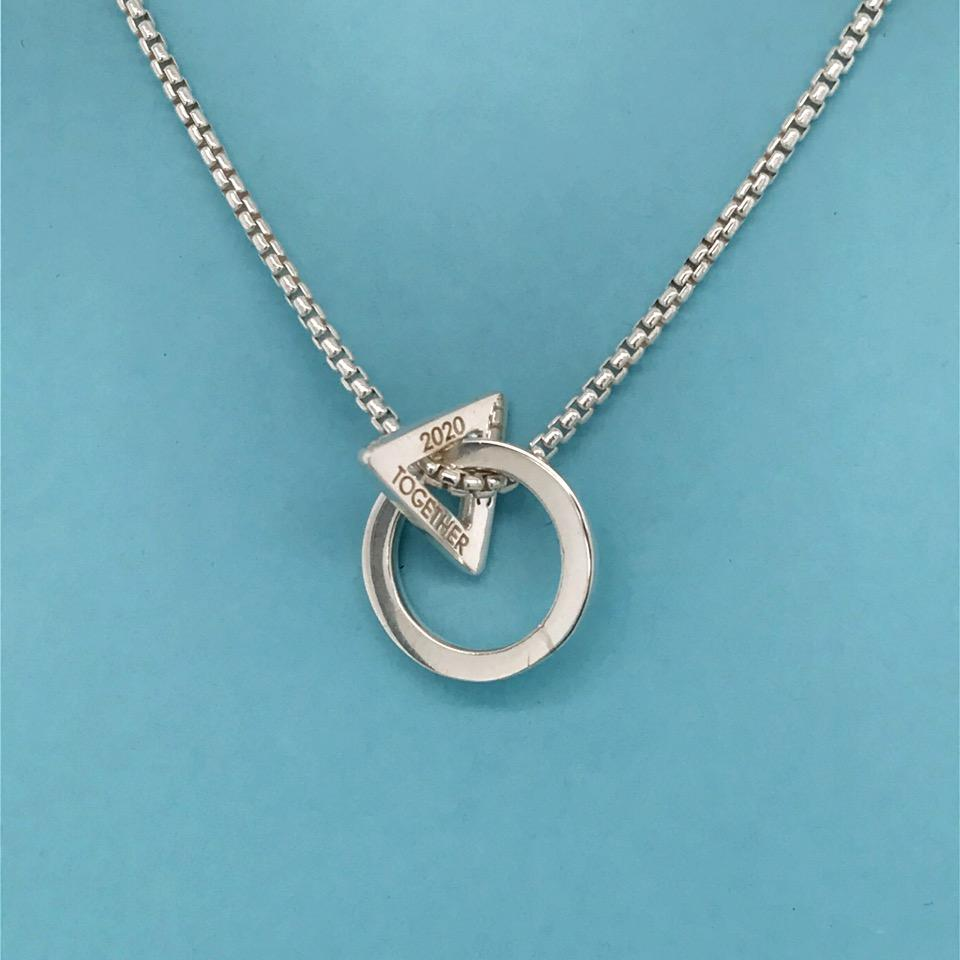 Engravable Together necklace in sterling silver, $150; available online at Elena Kriegner