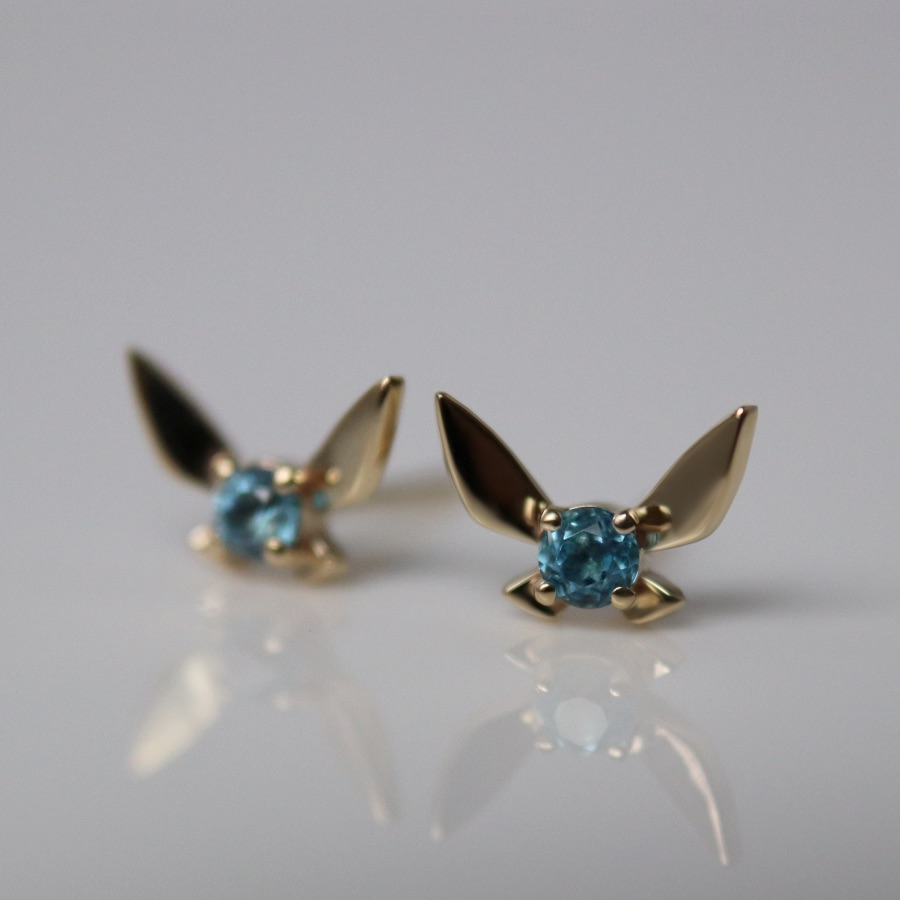 Fairy Companion stud earrings from the Hero of Time collection in 14k recycled gold with blue topaz is inspired by Navi, a helpful fairy companion in the Legend of Zelda: Ocarina of Time game, $715; available online at Soulboundnyc.com.