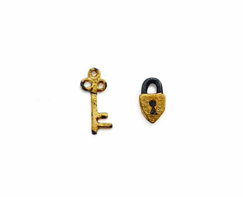Secret Garden stud earrings in oxidized silver with hand-applied 24k gold, $187; available online at Acanthus Jewelry