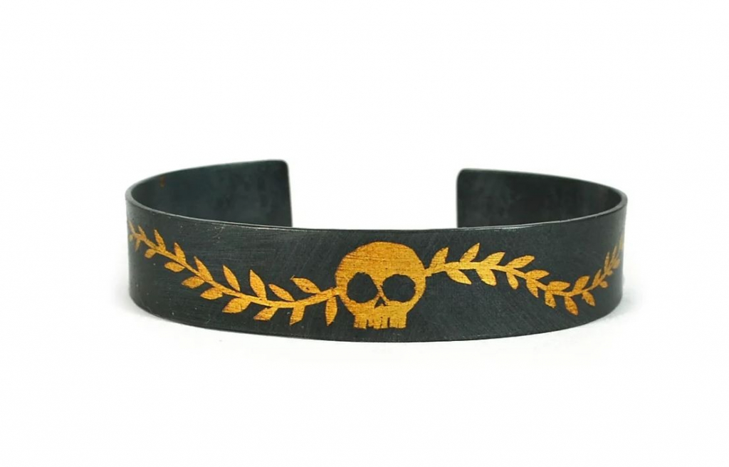 Laurel Skull cuff in oxidized silver with hand-applied 24k gold, $675; available online at Acanthus Jewelry