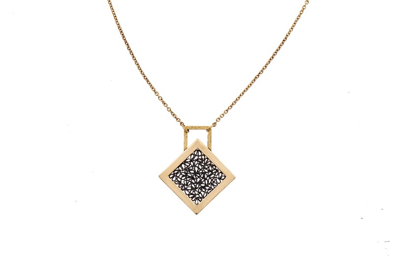 Window necklace in oxidized sterling silver and 18k yellow gold, $2,400; available online at Chandally