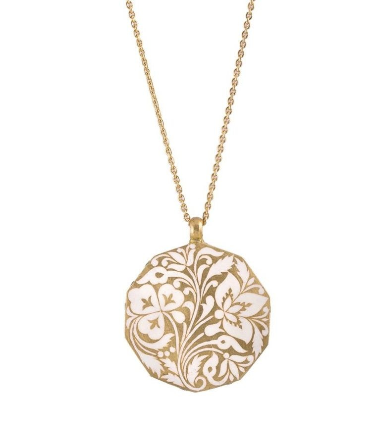 Jasmine Garden Amulet necklace in 22k gold with white vitreous enamel, $4,500; available online at Metalmark Fine Jewelry