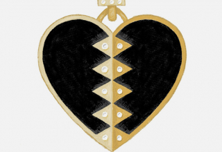Heart pendant in 18k gold with black onyx and diamonds, $2,500; available online at Harwell Godfrey