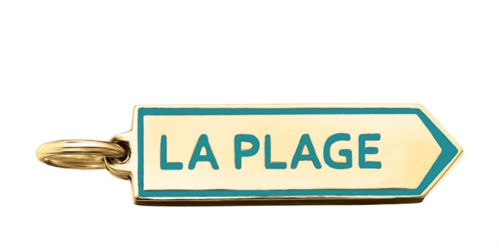 La Plage charm in 18k yellow gold with teal enamel served as the inspiration for the inlay chains, $695; available online from Delphine Leymarie