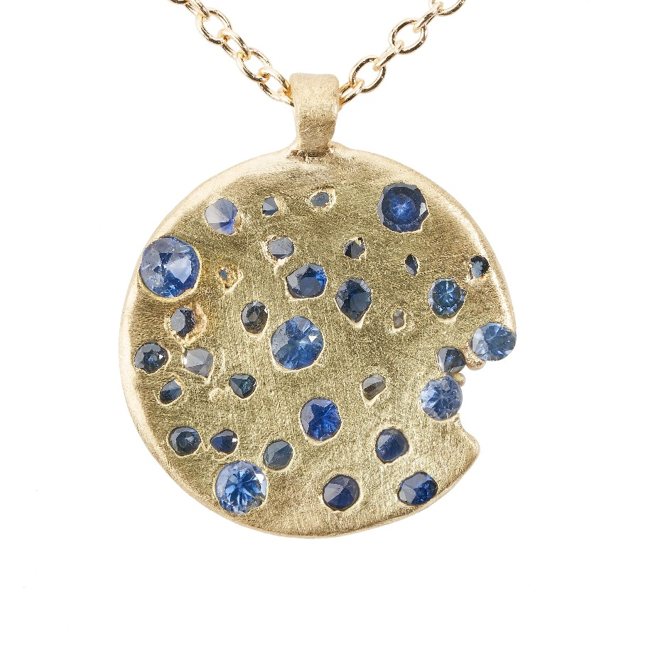 Constellation necklace in 18k yellow gold with blue sapphires, $1,960; available online at Polly Wales