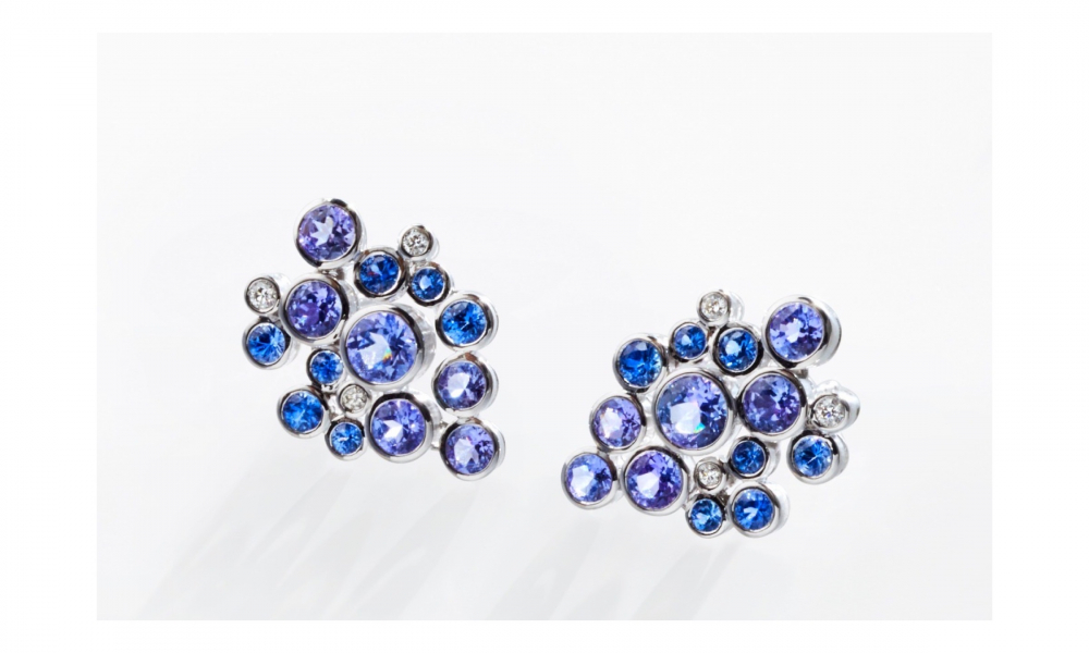 Constellation earrings in 14k white gold with 3.35 cts. t.w. mixed-color sapphires and tanzanite, and 0.101 ct. t.w. colorless diamonds. $2,255; email mseely@comcast.net