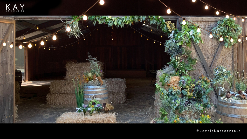 A rustic barn backdrop from Kay Jewelers