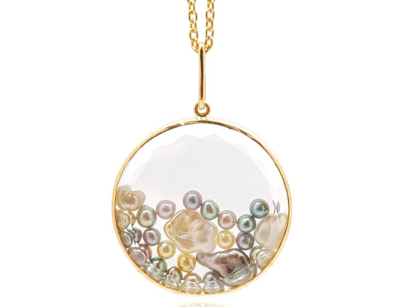 Mar 24 necklace in 18k yellow gold with saltwater akoya and South Sea keshi pearls encased in a white sapphire kaleidoscope shaker, $4,200; available online from Moritz Glik