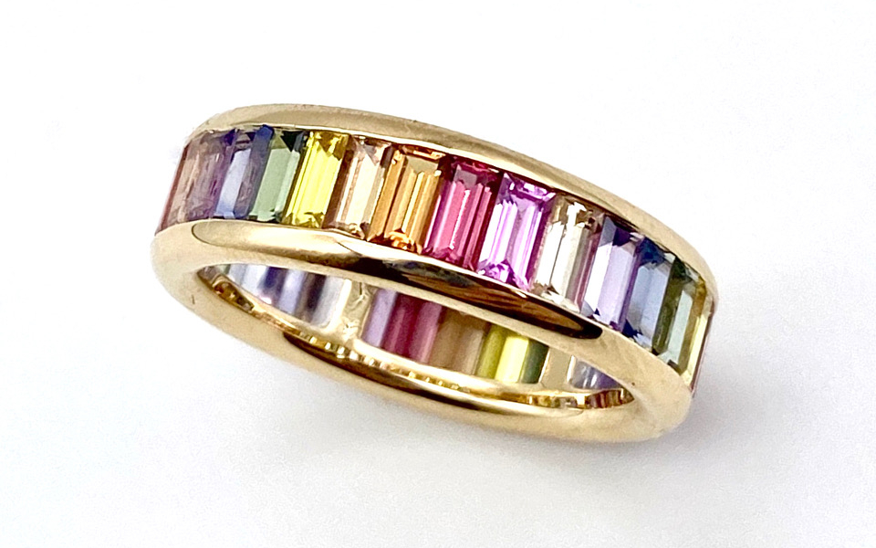 Cirque Vertical Baguette Eternity band in 14k yellow gold with multicolor baguette-cut sapphires, $4,125; email cleo@janetaylor.com for purchase