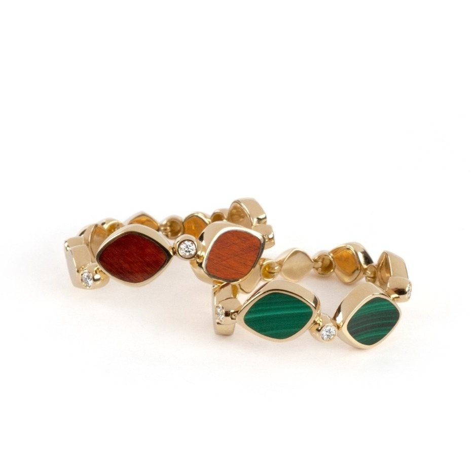 Pebbles rings in 18k gold with Tigers Eye or Malachite, $3,200 apiece; email massimo@sobeluxury.net for purchase