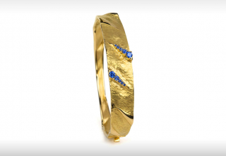 Bracelet in 18k yellow gold with 0.058 ct. t.w. blue sapphires by Vendorafa, $4,200; email massimo@sobeluxury.net for purchase