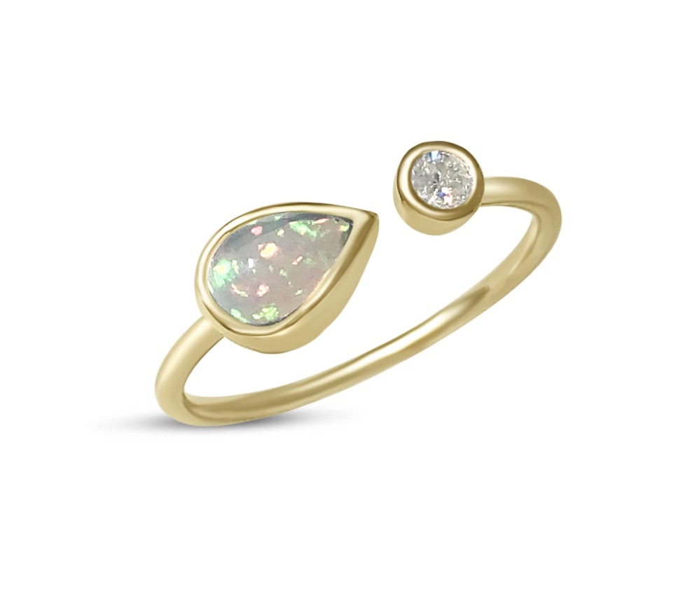 Ring in 14k yellow gold with 0.65 ct. t.w. Ethiopian opal and 0.07 ct. t.w. diamonds, $595; available online at Atelier All Day