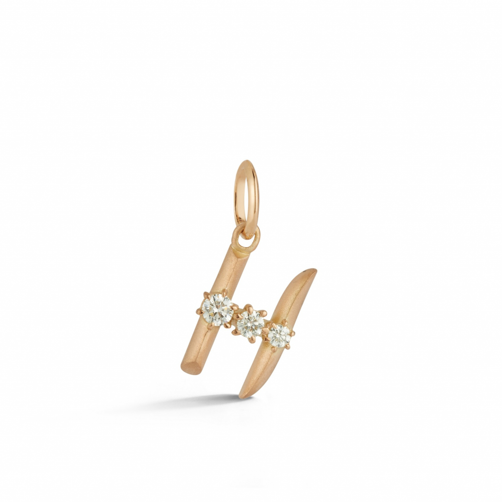 H Letter charm in 18k rose gold with 0.16 cts. t.w., $1,450; wendy@jadetrau.com for purchase