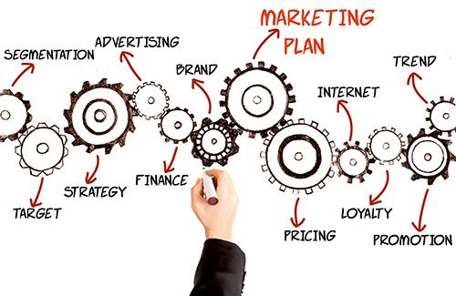 Businessman writing marketing plan.