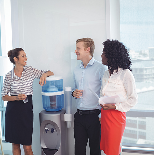 photo of employees at a water cooler