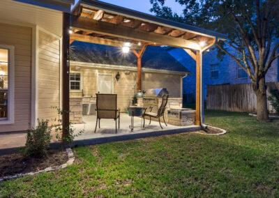Cooley backyard night kitchen