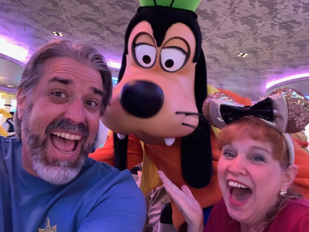 Tom and Michelle with Goofy aboard the Disney Wonder - Our Panama Canal Disney Cruise Recap