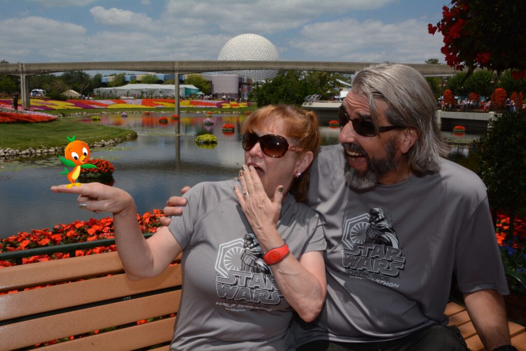 Tom and Michelle Memory Maker Photo with Orange Bird - Epcot International Festival of the Arts - Disney's Underrated Festival