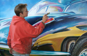 Artist Resume - Lory Lockwood painting Corvette Stingray