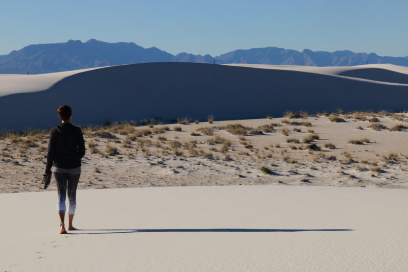 Deborah walking on the dunes in White Sands