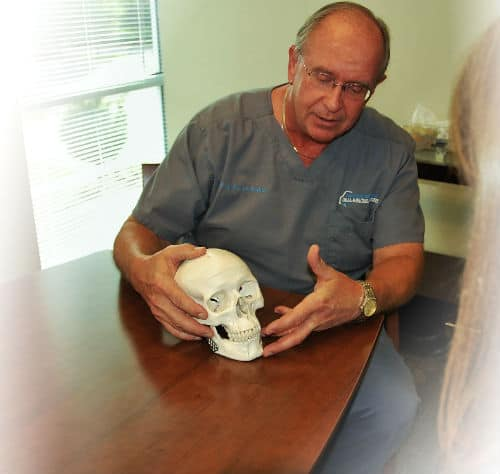 Charlotte oral surgeon Dale Misiek consults with a patient