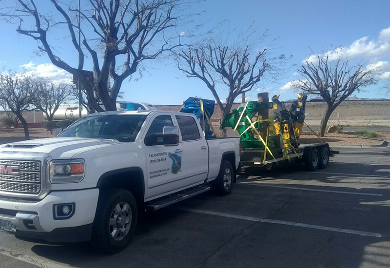 Excavator Tek truck loaded with attachments